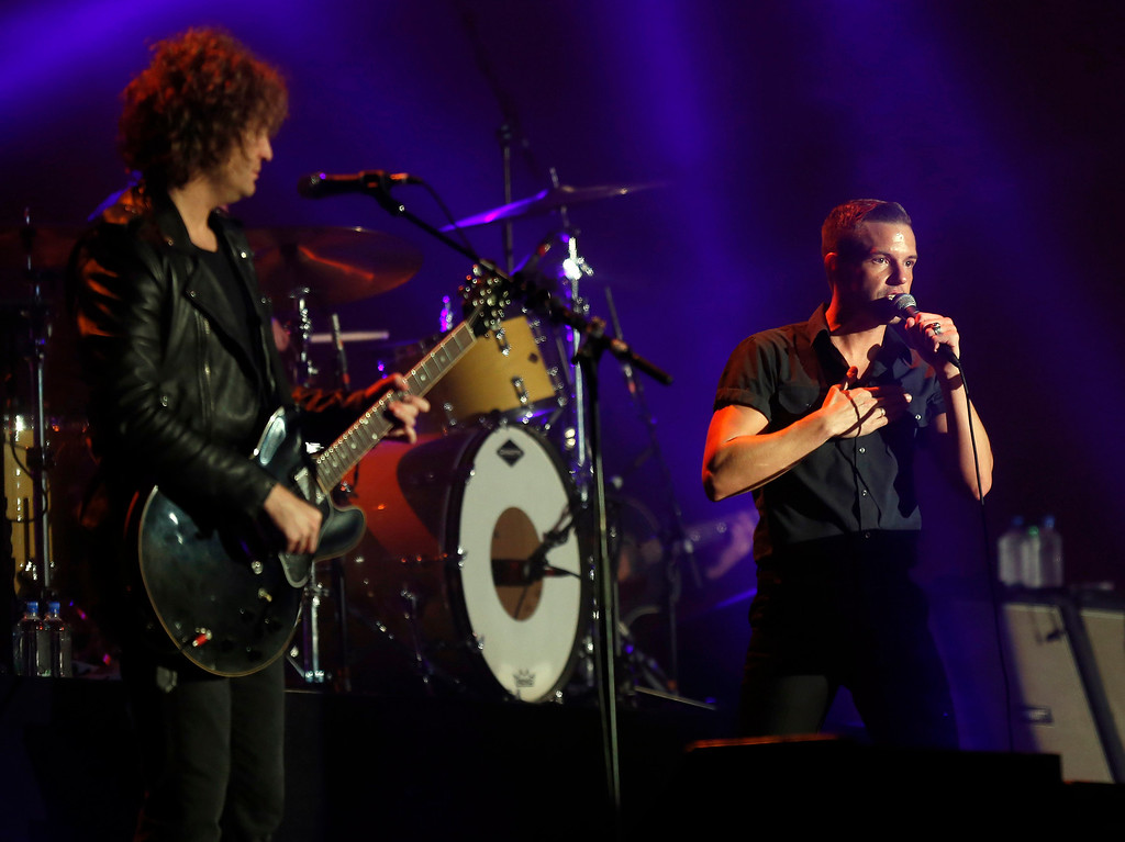 . Lead singer Brandon Flowers, right, and guitarist Dave Keuning, left, of The Killers perform on the Land\'s End stage during the last day of the Outside Lands music festival at Golden Gate Park in San Francisco, Calif., on Sunday, Aug. 10, 2014. (Jane Tyska/Bay Area News Group)