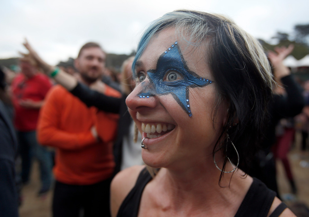 . Jen Stevens, of San Simeon, watches bands perform on the Land\'s End stage during the last day of the Outside Lands music festival at Golden Gate Park in San Francisco, Calif., on Sunday, Aug. 10, 2014. (Jane Tyska/Bay Area News Group)
