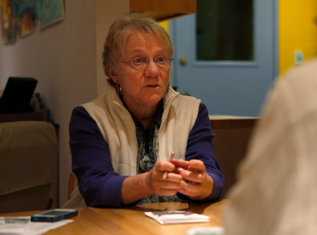 . Bonne Goltz Reiser talks to her partner, Suzanne Leib,  in their home in El Cerrito, Calif., on Monday, March 3, 2014.  Reiser was originally hesitant to get a hearing aid, but she\'s now glad that she did. (Nhat V. Meyer/Bay Area News Group)
