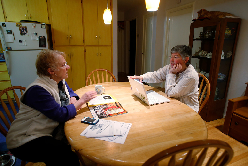 . Bonne Goltz Reiser, left, talks to her partner Suzanne Leib as Max, one of their two cats, far right, watches over them in their home in El Cerrito, Calif., on Monday, March 3, 2014.  (Nhat V. Meyer/Bay Area News Group)