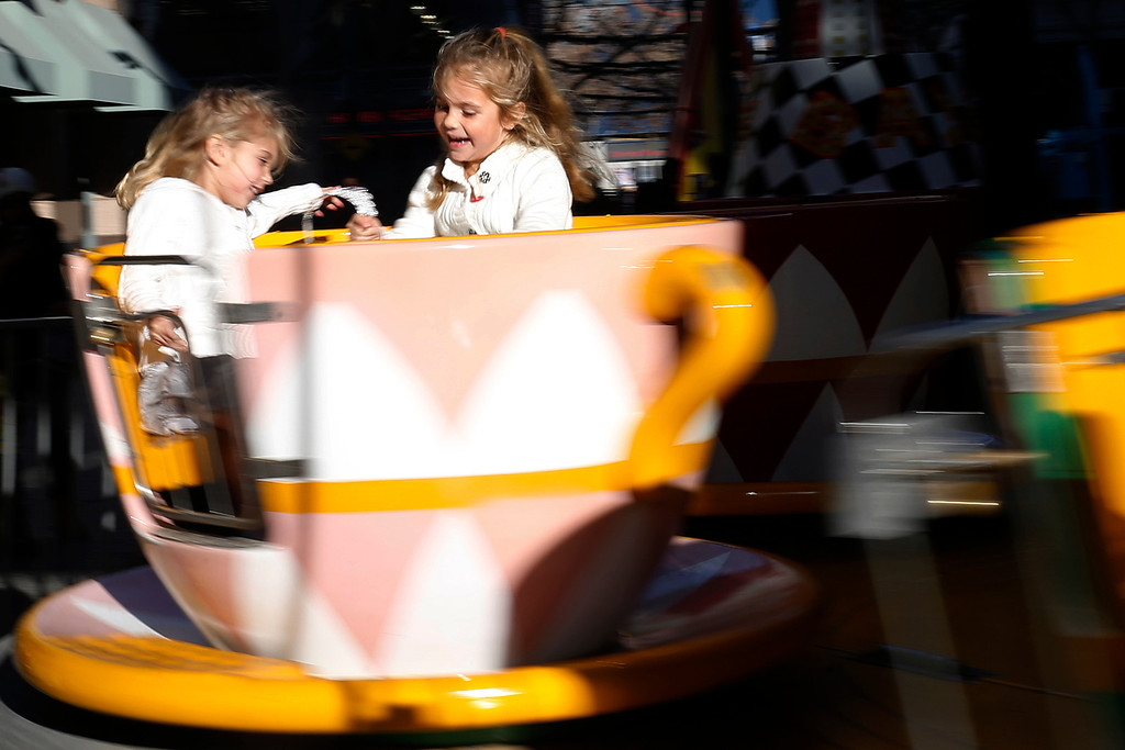 . Summer Johnson, 4,  and Casey Johnson, 6, who is celebrating her birthday, ride the Tea Cup at the Winter Wonderland in downtown San Jose, Calif., on Saturday, Jan. 4, 2014. (Josie Lepe/Bay Area News Group)
