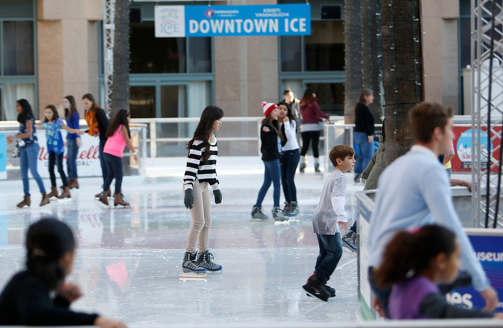 . A crowd skates at Downtown Ice at the Circle of Palms in downtown San Jose, Calif., on Saturday, Jan. 4, 2014. (Josie Lepe/Bay Area News Group)