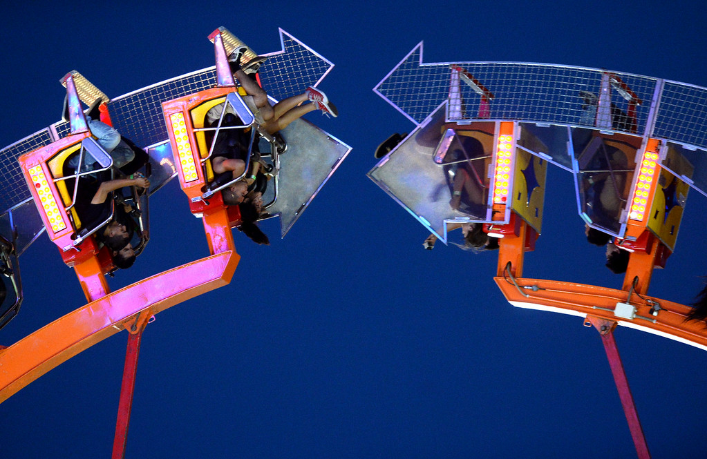 . Fairgoers ride the Footloose carnival ride at the Alameda County Fair in Pleasanton, Calif., on July 5, 2014. (Doug Duran/Bay Area News Group)
