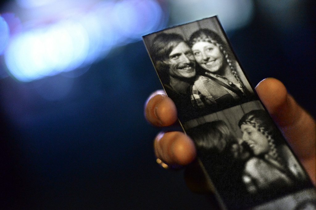 . Mary Rowley holds a photo of herself and her boyfriend, Eric Polinski, who are both visiting from of Kailua, Hawaii, while attending the Alameda County Fair in Pleasanton, Calif., on Saturday, July 5, 2014. (Doug Duran/Bay Area News Group)
