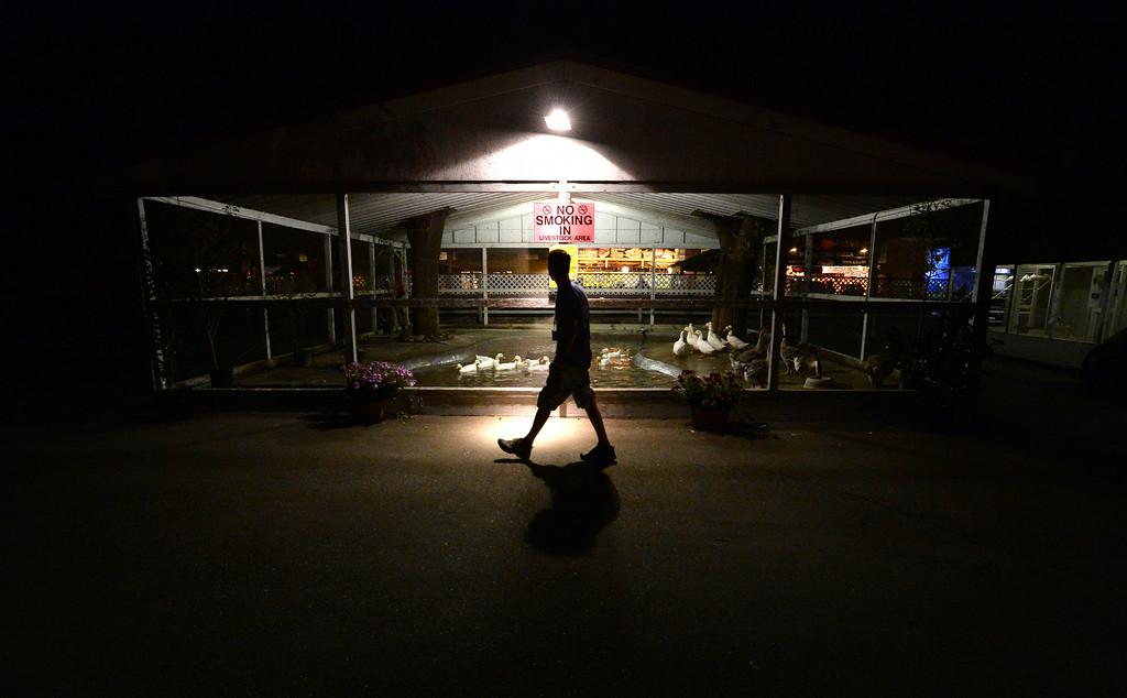 . A person walks through the Alameda County Fair at closing time in Pleasanton, Calif., on Thursday, June 26, 2014. (Doug Duran/Bay Area News Group)
