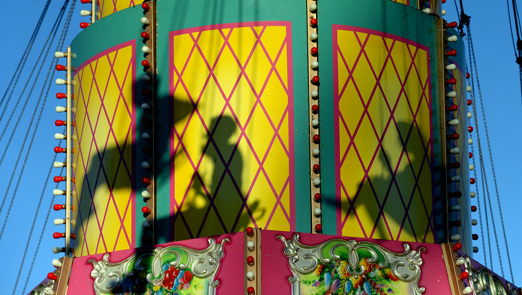 . The shadows of fairgoers as they swing through the air on the Wave Swinger carnival ride at the Alameda County Fair on Tuesday, July 1, 2014. (Doug Duran/Bay Area News Group)