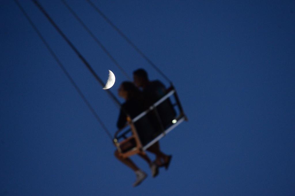 . With the moon overhead, fairgoers ride the Vertigo carnival ride at the Alameda County Fair in Pleasanton, Calif., on July 3, 2014. (Doug Duran/Bay Area News Group)