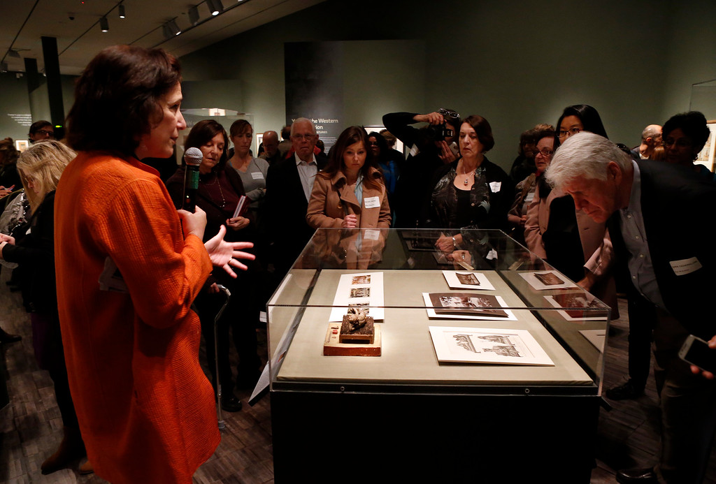 """. Debra Diamond, a Smithsonian associate curator of south and southeast Asian art, explains a display at the new exhibit \""""Yoga: The Art of Transformation\"""" at the Asian Art Museum Wednesday morning, Feb. 19, 2014, in San Francisco, Calif. The exhibit was first displayed at the Smithsonian. (Karl Mondon/Bay Area News Group)"""