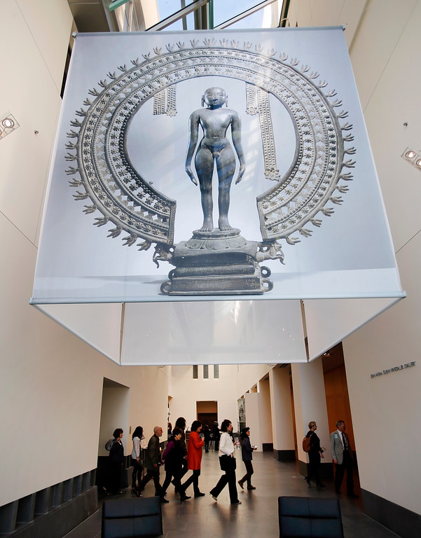 """. A blow-up of an 11th century sculpture, \""""Standing Jina\"""", adorns the lobby of the Asian Art Museum for their new exhibit, \""""Yoga: The Art of Transformation\"""" at the Asian Art Museum Wednesday morning, Feb. 19, 2014, in San Francisco, Calif. (Karl Mondon/Bay Area News Group)"""