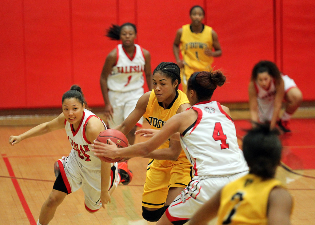 . Bishop O\'Dowd\'s Daniella Williams (14) tries to drive past Salesian\'s Mariya Moore (4) as she is fouled during a nonleague game at Salesian High School in Richmond, Calif., on Saturday, Jan. 11, 2014. Bishop O\'Dowd won 60-56. (Ray Chavez/Bay Area New Group)