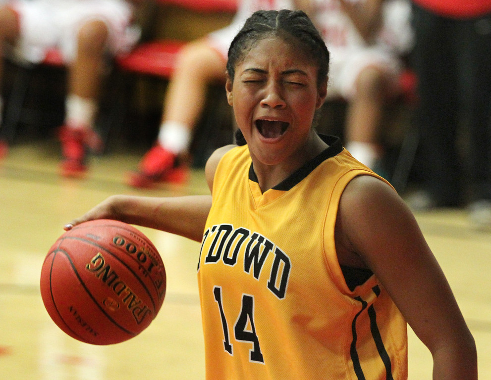 . Bishop O\'Dowd\'s Daniella Williams (14) reacts  as she disagrees with a referee\'s call during a nonleague game against Salesian at Salesian High School in Richmond, Calif., on Saturday, Jan. 11, 2014. Bishop O\'Dowd won 60-56. (Ray Chavez/Bay Area New Group)