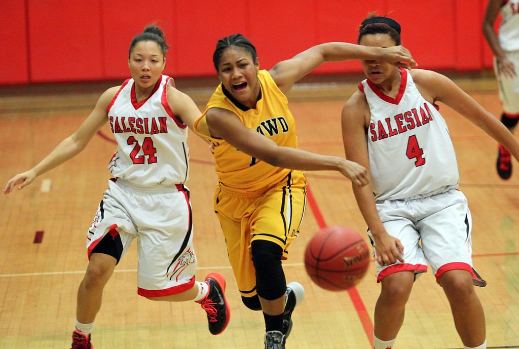 . Bishop O\'Dowd\'s Daniella Williams (14) is fouled by Salesian\'s Mariya Moore (4) during a nonleague game at Salesian High School in Richmond, Calif., on Saturday, Jan. 11, 2014. Bishop O\'Dowd won 60-56. (Ray Chavez/Bay Area New Group)