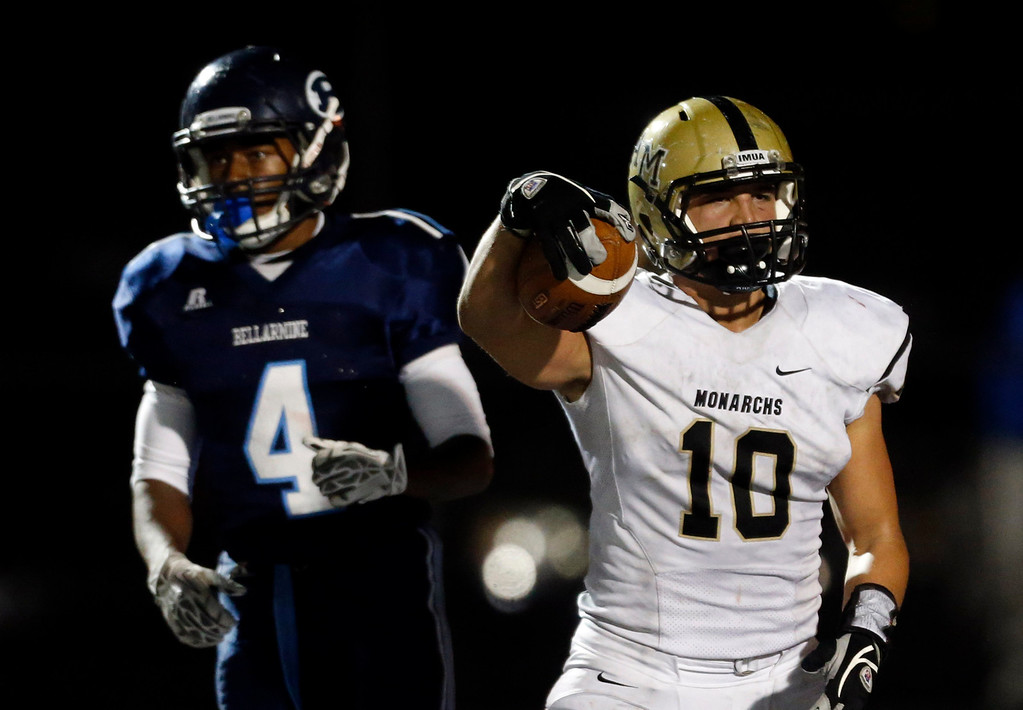 . Archbishop Mitty\'s Chandler Ramirez (10) scores a touchdown against Bellarmine College Prep\'s Grant Bush (4) in a WCAL football game Friday night, Nov. 8, 2013 at San Jose City College in San Jose, Calif. (Karl Mondon/Bay Area News Group)