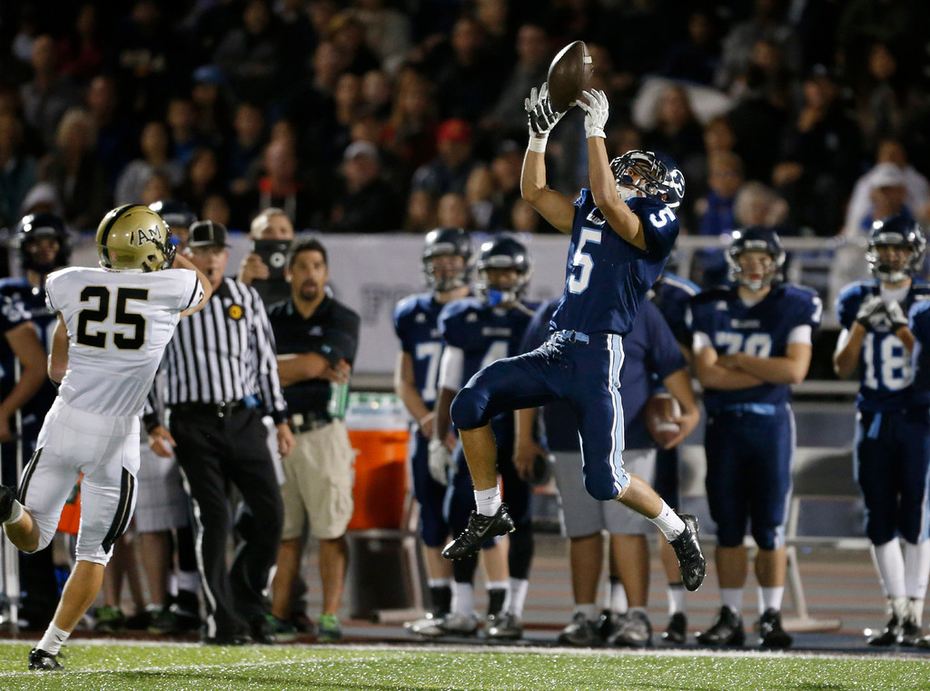. Bellarmine College Prep\'s Kyle MacAuley (5) catches a pass against Archbishop Mitty\'s Trevor Lewis (25) in the first half of their WCAL football game Friday night, Nov. 8, 2013 at San Jose City College in San Jose, Calif. (Karl Mondon/Bay Area News Group)