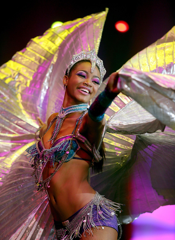 . A dancer in the Caribbean segment performs during the UniverSoul Circus show under the big top on Hegenberger Road in Oakland, Calif., on Friday, April 5, 2013.  (Jane Tyska/Staff)