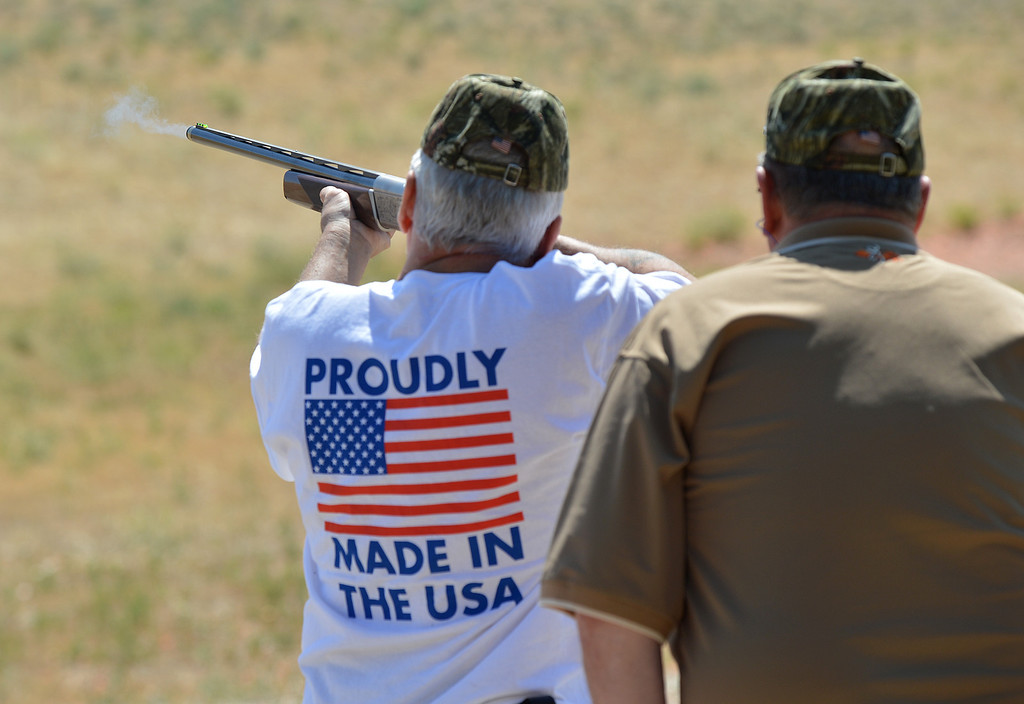 . Wayne Haire, of Brentwood, left, takes a shot at a flying clay target, as coach Harry Kinney looks on from behind during the George Findly Memorial Disabled Veteran Trap Shoot at the Bay Point Rod and Gun Club in Concord, Calif., on Saturday, June 15, 2013.  Each vet was assigned a mentor/coach from the club and each got to shoot two sets of flying clay targets.  (Dan Rosenstrauch/Bay Area News Group)