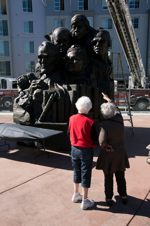". Unidentified spectators take in the sight of Mario Chiodo\'s ""Remember Them\"" statue, at a ceremony to dedicate the fourth and final section of the artist tribute to heroes of civil rights and humanity, Thursday, Feb. 21, 2013 in Oakland Calif. (D. Ross Cameron/Staff)"