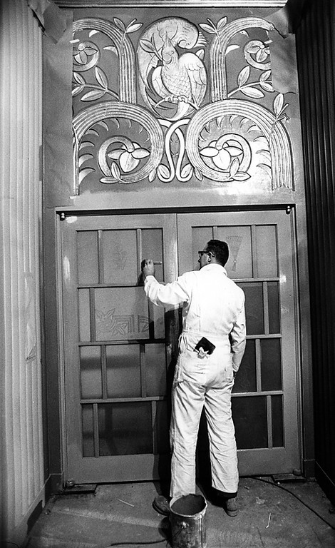 . A worker puts finishing touches on trim work inside the Paramount Theatre in Oakland in 1973. The theater, which opened in 1931, fell into disrepair and was in danger of being demolished when the Oakland East Bay Symphony chose it for its new home in 1970. The newly renovated theatre reopened in 1973. (Kenneth Green/Bay Area News Group Staff Archives)