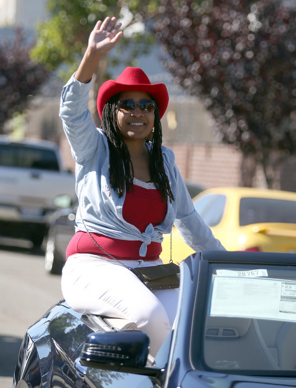 . Oakland City Council District 3 representative Lynette Gibson McElhaney waves to the crowd during the 39th annual Oakland Black Cowboy Parade and Heritage Festival in Oakland, Calif., on Saturday, Oct. 5, 2013. The event also featured food, entertainment and pony rides for kids at De Fremery Park. The Oakland Black Cowboy Association began in 1975 and educates the public about the role that black cowboys played in history and building of the west. (Jane Tyska//Bay Area News Group)