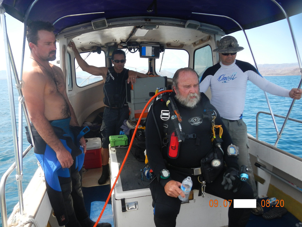 . From left, KC Stocks, Joe Jacinto, Wings Stocks and Dale Pearson, the team assembled to dive the Erik this past September, prepare Wings for a solo dive near the wreckage site.   (Courtesy of Joe Jacinto)