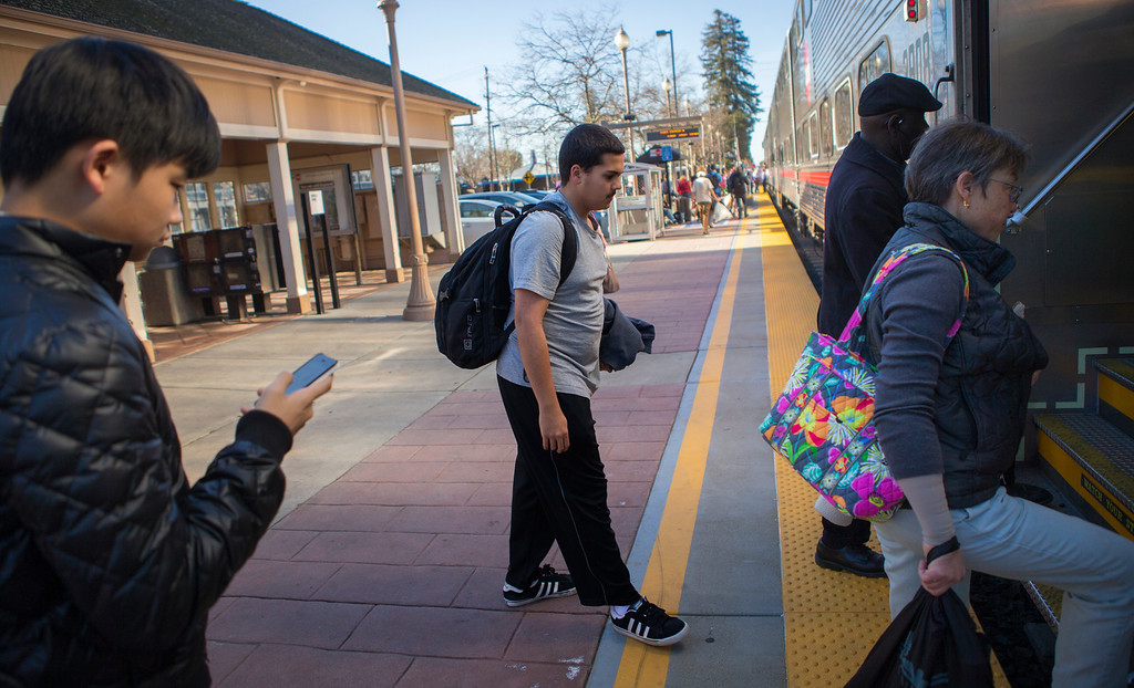 . Kieran Rege, middle, 15, rides the train home in Menlo Park, Calif., on Wednesday, Jan. 20, 2013.  Diagnosed with autism when he was 3, Kieran is one of a growing number of children that have lost their diagnosis.Through behavioral, speech and dietary interventions, the Palo Alto teenager is now bright, sociable and confident. (John Green/Staff)