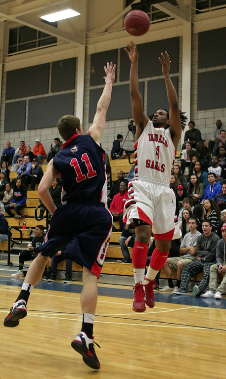 . Dublin\'s Jamir Andrews (4) shoots against Campolindo\'s Justin Bunh (11) in the first half of their high school basketball game in Dublin, Calif., on Friday, Jan. 18, 2013. (Anda Chu/Staff)