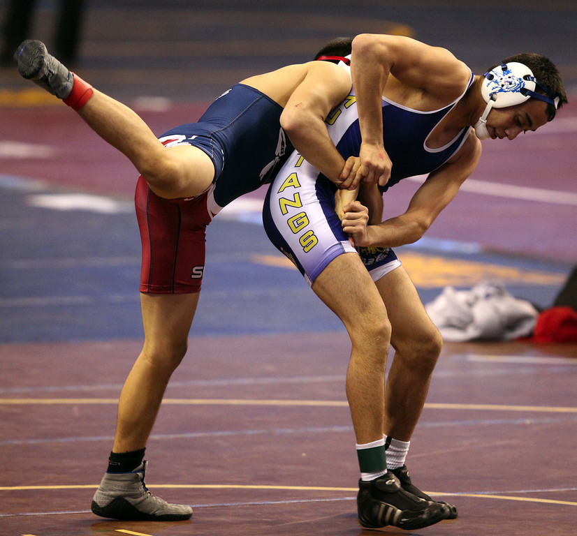 . Gilroy\'s Nikko Villarreal, right, wrestles Sanger\'s Rosario Sanchez in a 138-pound first round match during the California Interscholastic Federation wrestling championships in Bakersfield, Calif., on Friday, March 1, 2013. Villarreal would go onto win. (Anda Chu)