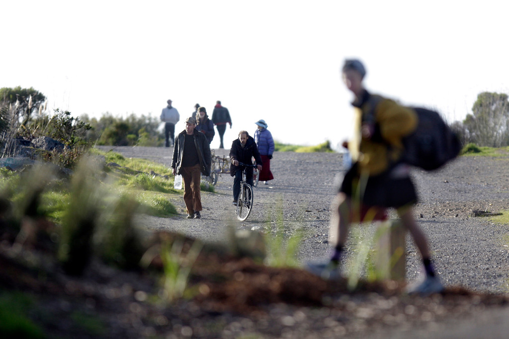 . Hikers and bicyclists enjoy the outdoors at the Albany Waterfront Trail, which is part of the Bay Trail seen at the end of Buchannan Street in Albany, Calif., on Thursday, Feb. 7, 2013. The Bay Trail\'s goal is to encircle the San Francisco Bay without breaking access to people ends at the Golden Gate Fields waterfront.  The East Bay Regional Park District is hoping to complete the project of the Bay Trail as they wait for a domain action court date with the Golden Gate Fields. (Ray Chavez/Staff)