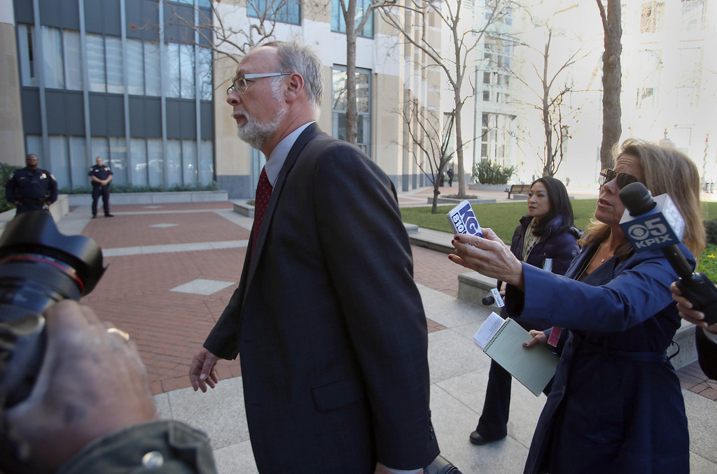 . Douglas C. Straus, an attorney for Children\'s Hospital Oakland, enters the United States District Court at the Ronald V. Dellums Federal Building as media ask questions in Oakland, Calif., on Friday, Jan. 3, 2014. (Jane Tyska/Bay Area News Group)