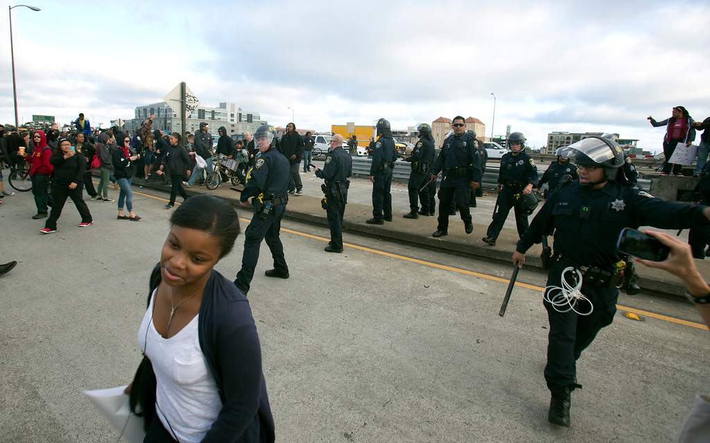 . Oakland police order demonstrators off northbound Interstate Highway 880 during a protest of the verdict in the Trayvon Martin murder trial last Saturday in Sanford, Fla., Monday, July 15, 2013 in Oakland, Calif. (D. Ross Cameron/Bay Area News Group)