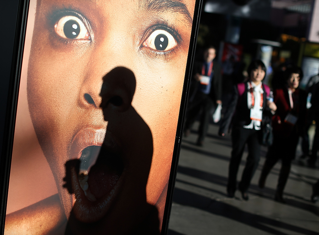 . Attendees walk by a Sony advertisement as they arrive at the 2013 International CES at the Las Vegas Convention Center on January 8, 2013 in Las Vegas, Nevada. (Photo by Justin Sullivan/Getty Images)
