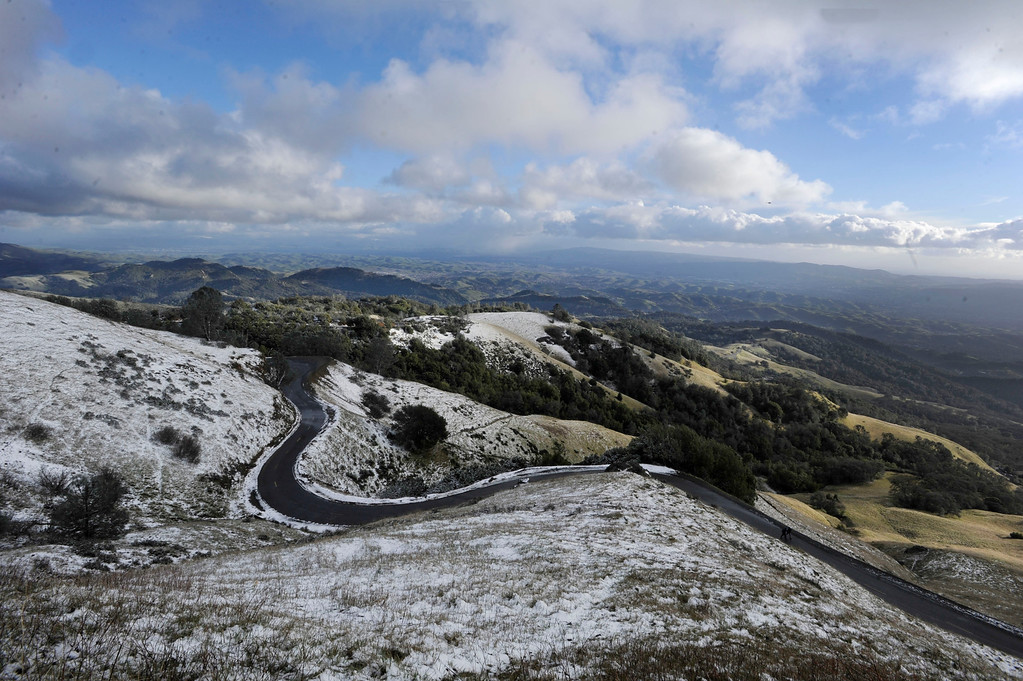 . Empty of motorists, the road heading to the summit at Mount Diablo State Park is framed with a dusting of snow in Walnut Creek, Calif., on Tuesday, Feb. 19, 2013. (Susan Tripp Pollard/Staff)