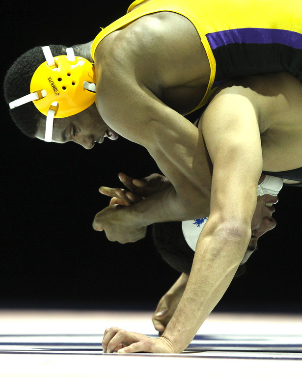 . Riodan\'s Elijah Davis, top, wrestles against  Gilroy\'s Nikko Villareal in the 138-pound championship match during the California Interscholastic Federation wrestling championships in Bakersfield, Calif., on Saturday, March 2, 2013. Villareal would go onto win 3-1. (Anda Chu/Staff)