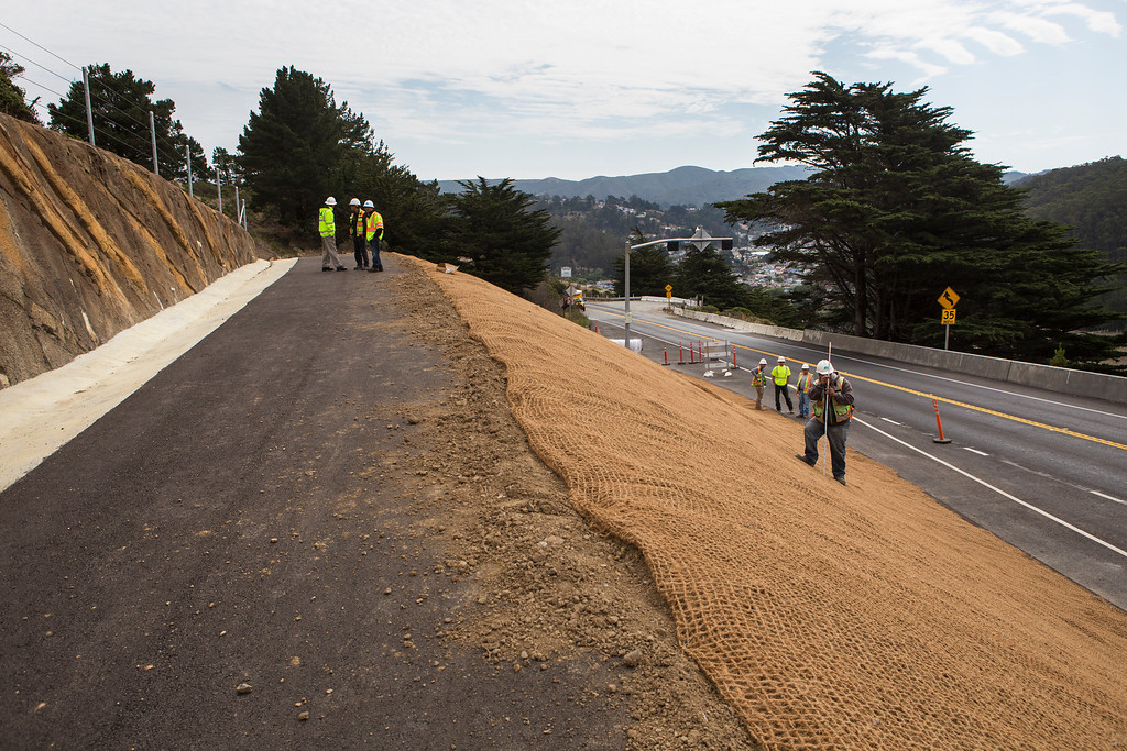 . Construction crews work on the new biking and hiking trail near the north end of the Devils Slide Bypass Tunnels, south of Pacifica, Calif., on Tuesday, July 23, 2013. The project includes roadway surfacing, signage, parking lots, habitat protection and overlooks.(John Green/Bay Area News Group)