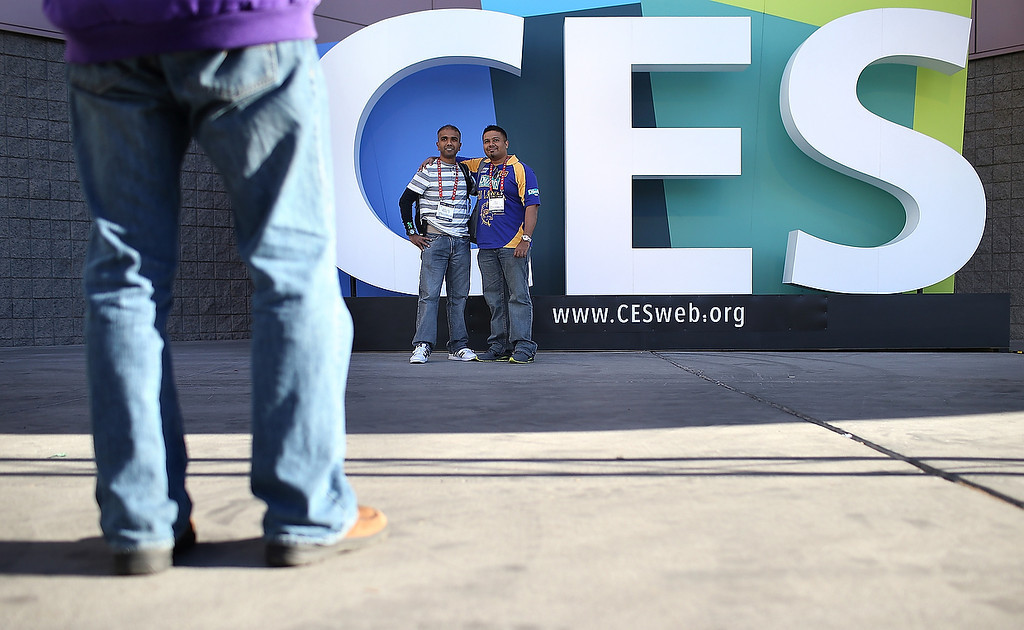 . Attendees take their photo in front of a sign as they arrive at the 2013 International CES at the Las Vegas Convention Center on January 8, 2013 in Las Vegas, Nevada. (Photo by Justin Sullivan/Getty Images)