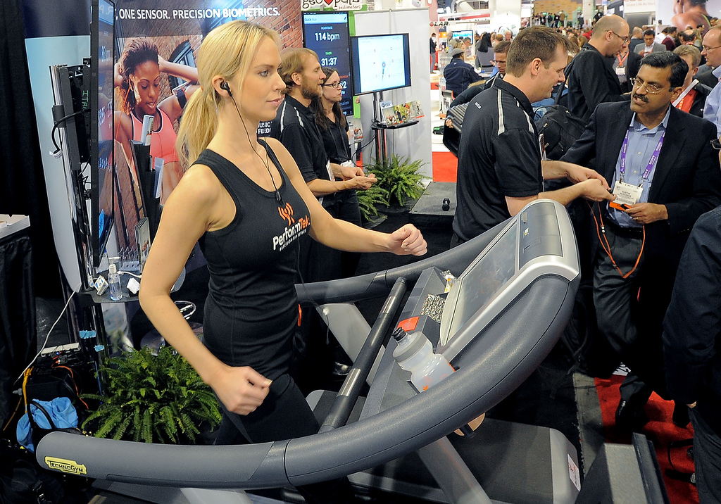 . Woman works out while her pulse and callories are monitored by PerformTech earbuds made by Valencell at the Las Vegas Convention Center on January 9, 2013 in Las Vegas, Nevada. (JOE KLAMAR/AFP/Getty Images)