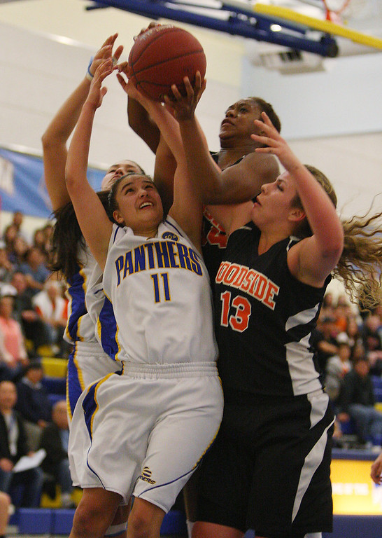 . Presentation\'s Courtney Danna fights for a rebound with Woodside\'s Sharnon Lionel, top, and Madison Michelis in the third quarter during the CCS Division II girls basketball finals at Santa Clara High School in Santa Clara, Calif. on Friday, March 1, 2013. The Presentation Panthers beat the Woodside Wildcats, 49-34. (Jim Gensheimer/Staff)