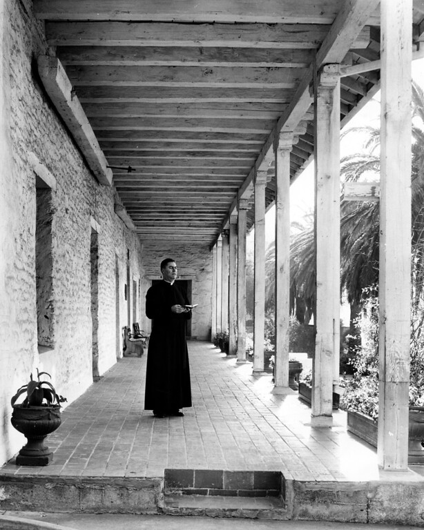 . December 5, 1962 - A priest at the Mission. (Art Vargas / Oakland Tribune Staff Archives)