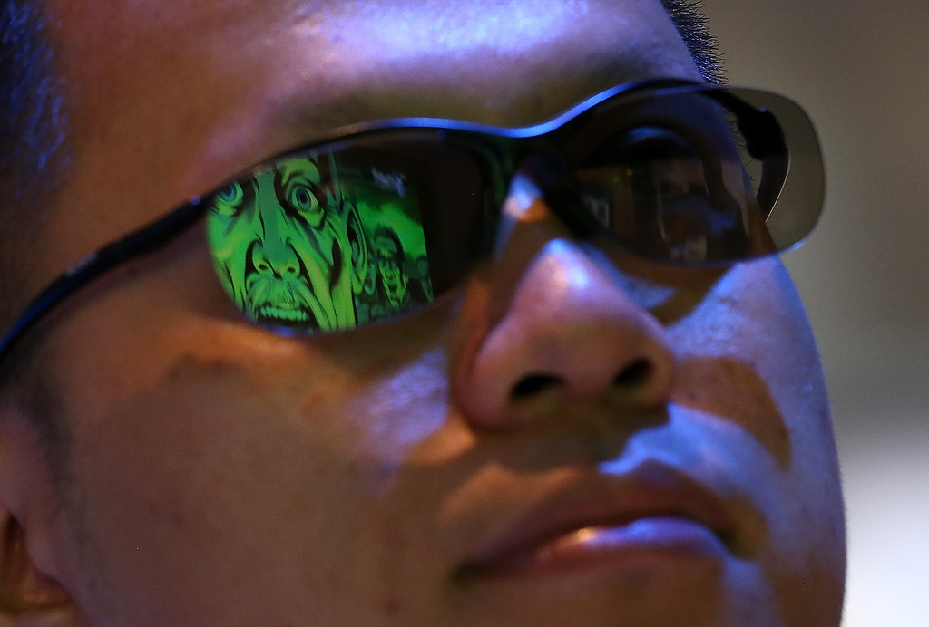 . A Sony 3-D movie is seen reflected in an attendee\'s glasses during the 2013 International CES at the Las Vegas Convention Center on January 8, 2013 in Las Vegas, Nevada. (Photo by Justin Sullivan/Getty Images)