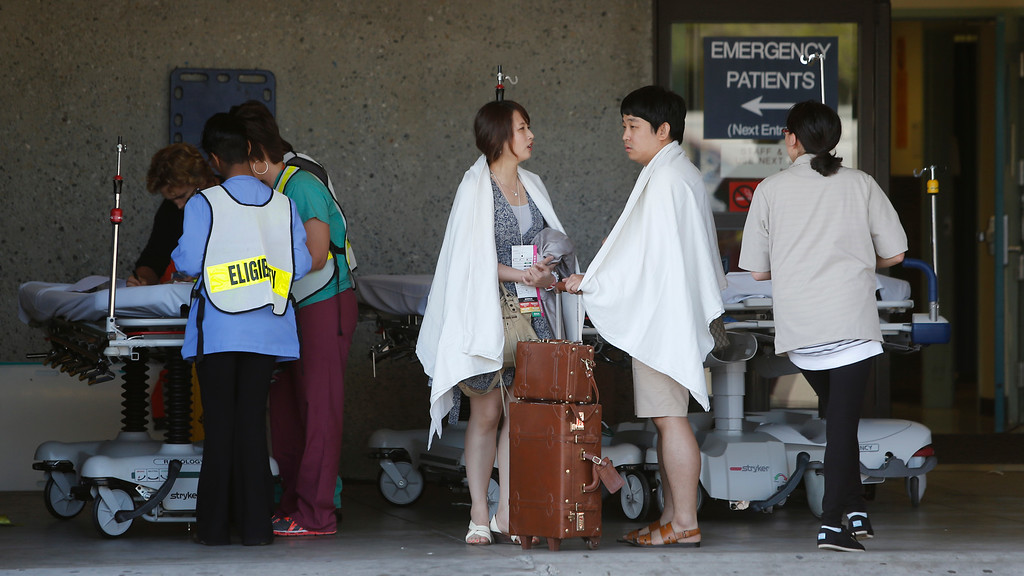 . Passengers on the Asiana Airlines Flight 214 that crashed at San Francisco International Airport are treated at San Francisco General Hospital on Saturday, July 6, 2013. (John Green/Bay Area News Group)