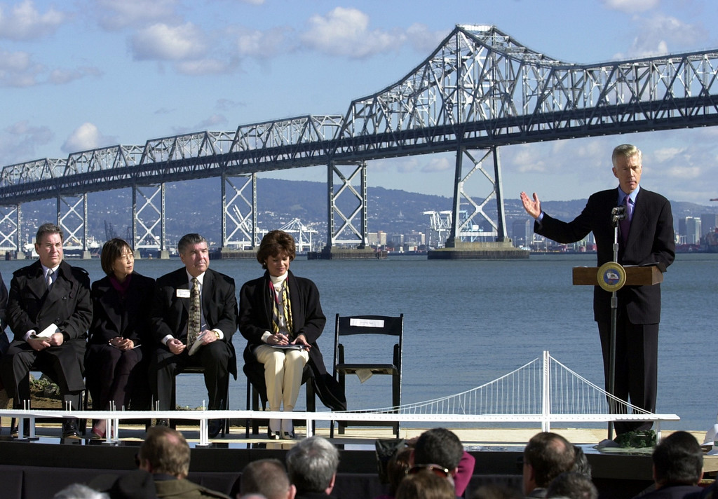 . Governor Gray Davis spoke Jan. 29, 2002 at the groundbreaking for the $2.6 billion Bay Bridge replacement project for the eastern span. (Note how the cost estimate has more than doubled in the past 13 years). A model of the single tower span sits on the stage in the foregound of the 65-year-old cantilever bridge. (Contra Costa Times/Karl Mondon)
