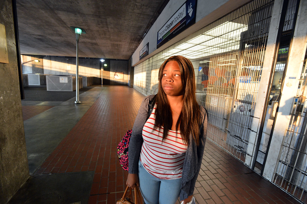 . Aisha Edmonds, of Antioch, ponders her options for getting to work in Pittsburg after learning of the BART strike at the MacArthur station in Oakland, Calif. on Monday, July 1, 2013. (Kristopher Skinner/Bay Area News Group)