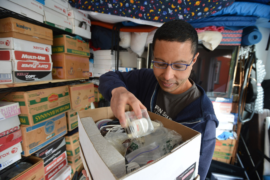 """. Peter Mui sorts through a box of repair material at his home in Berkeley, Calif. on Tuesday, Feb. 5, 2013. Mui and others run \""""Fixit Clinics,\"""" where they assist people in the repair of various electrical appliances, from televisions to toasters. (Kristopher Skinner/Staff)"""