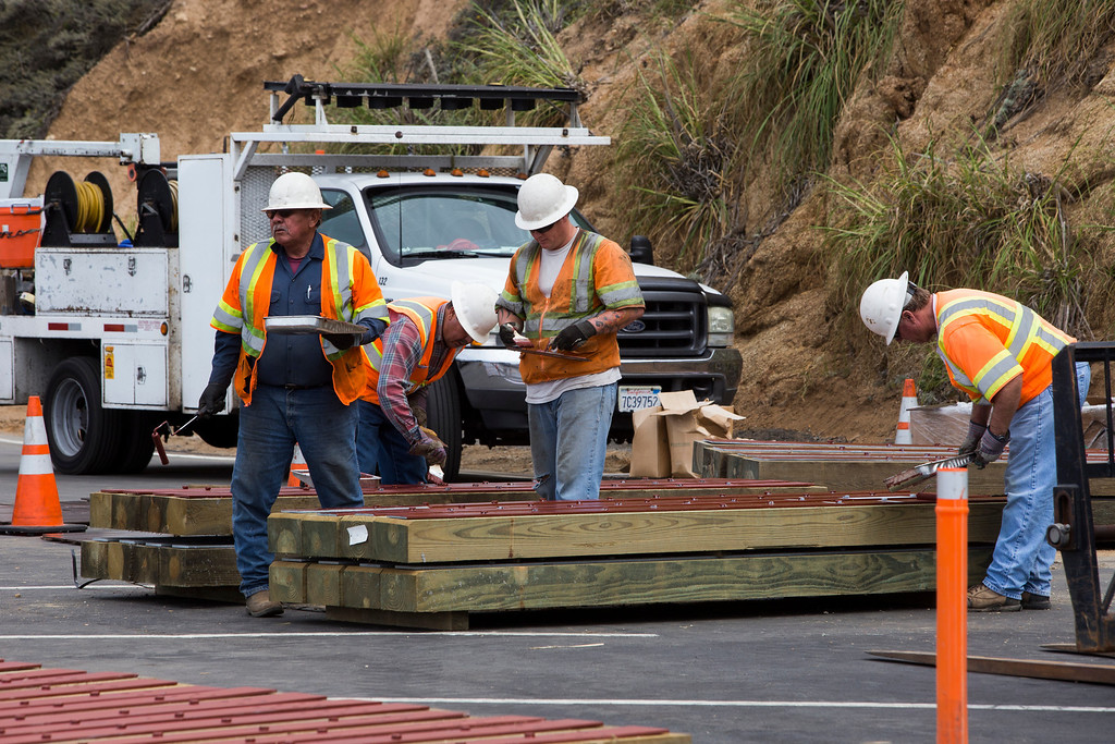 . Construction crews work on fence posts for the parking lot view area of the closed off section of Highway 1 on the south end of the Devils Slide Tunnel on Tuesday, July 23, 2013. (John Green/Bay Area News Group)