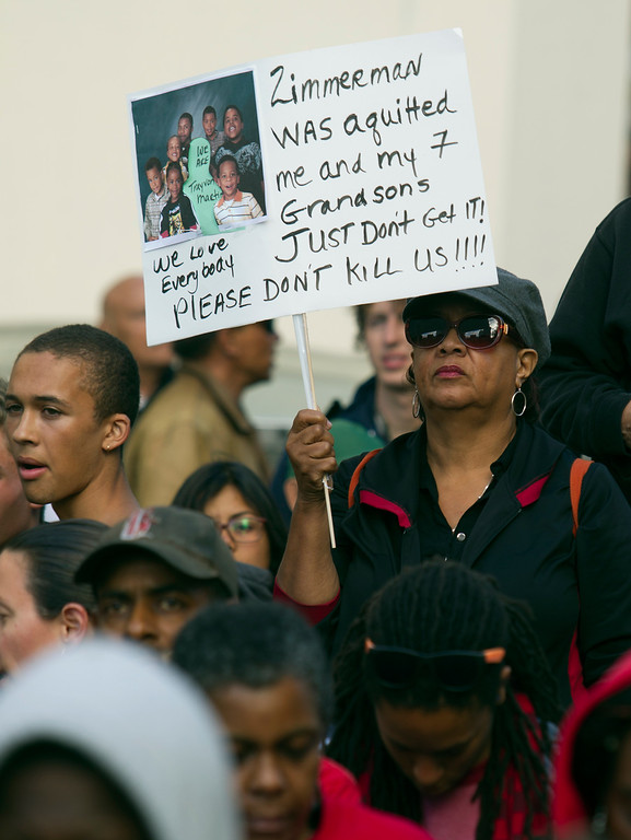 . Demonstrators mass at Frank H. Ogawa Plaza during a protest of the verdict in the Trayvon Martin murder trial last Saturday in Sanford, Fla., Monday, July 15, 2013 in Oakland, Calif. (D. Ross Cameron/Bay Area News Group)