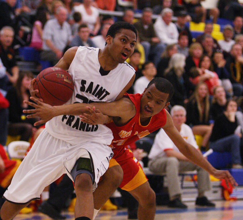 . St. Francis\' Khalil Johnson is fouled by Willow Glen\'s Omar Cross in the second quarter during the CCS Division II boys basketball finals at Santa Clara High School in Santa Clara, Calif. on Friday, March 1, 2013. The Saint Francis Lancers played the Willow Glen Rams. (Jim Gensheimer/Staff)