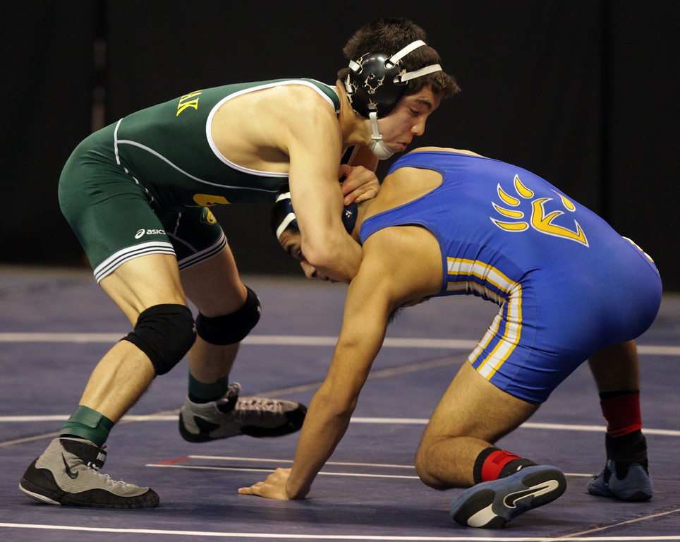 . Live Oak\'s Isaiah Locsin, left, wrestles Exeter Arnulfo Olea in a 120-pound third round match during the California Interscholastic Federation wrestling championships in Bakersfield, Calif., on Friday, March 1, 2013. Locsin would go on to win. (Anda Chu/Staff)