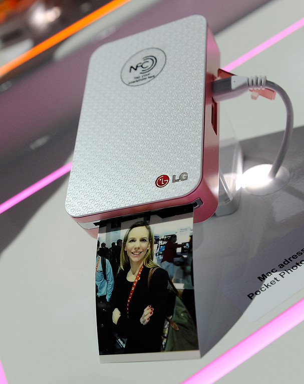 . A photograph emerges from a LG Pocket Photo printer that uses NFC technology  at the 2013 International CES at the Las Vegas Convention Center on January 8, 2013 in Las Vegas, Nevada. (Photo by David Becker/Getty Images)