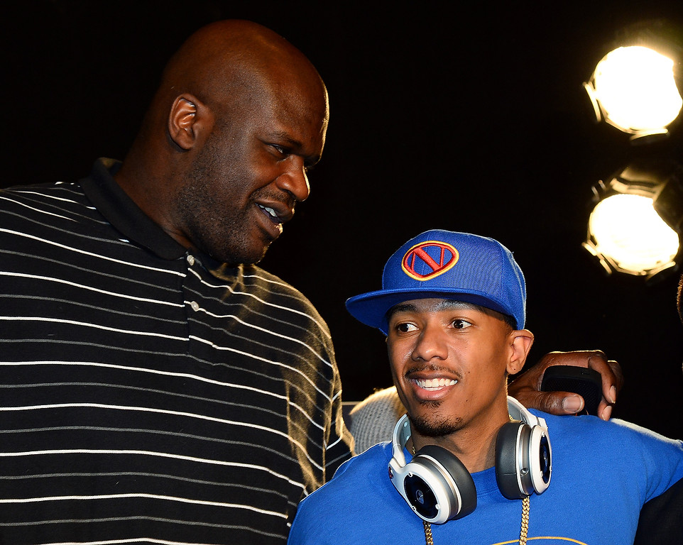 . Former NBA player Shaquille O\'Neal (L) and actor/media personality Nick Cannon talk after a press event for Monster Inc. at the Mandalay Bay Convention Center for the 2014 International CES on January 6, 2014 in Las Vegas, Nevada. (Ethan Miller/Getty Images)