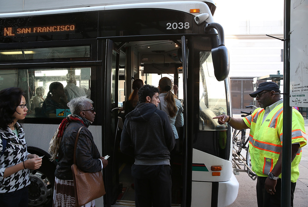 . Commuters board an AC Transit bus on July 1, 2013 in Oakland, California. (Photo by Justin Sullivan/Getty Images)